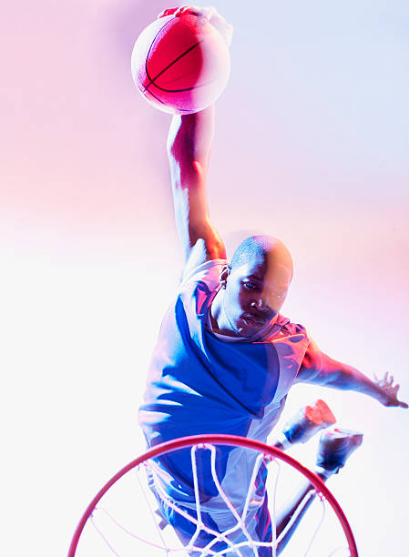 Blurred view of basketball player dunking  slam dunk stock pictures, royalty-free photos & images