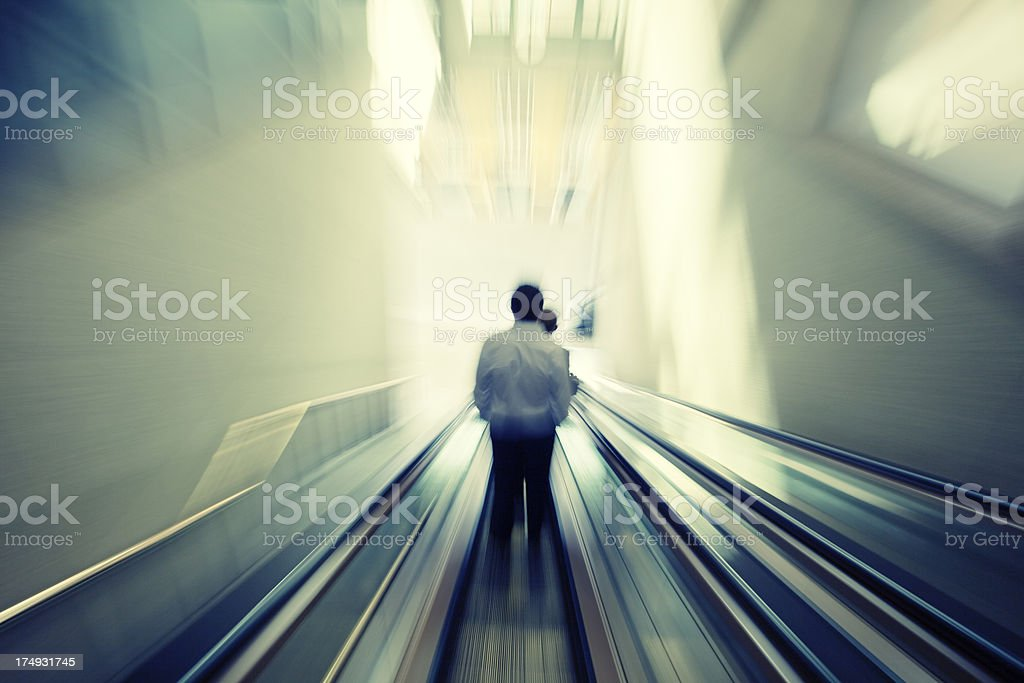 Blurred View of Businessman on Escalator royalty-free stock photo
