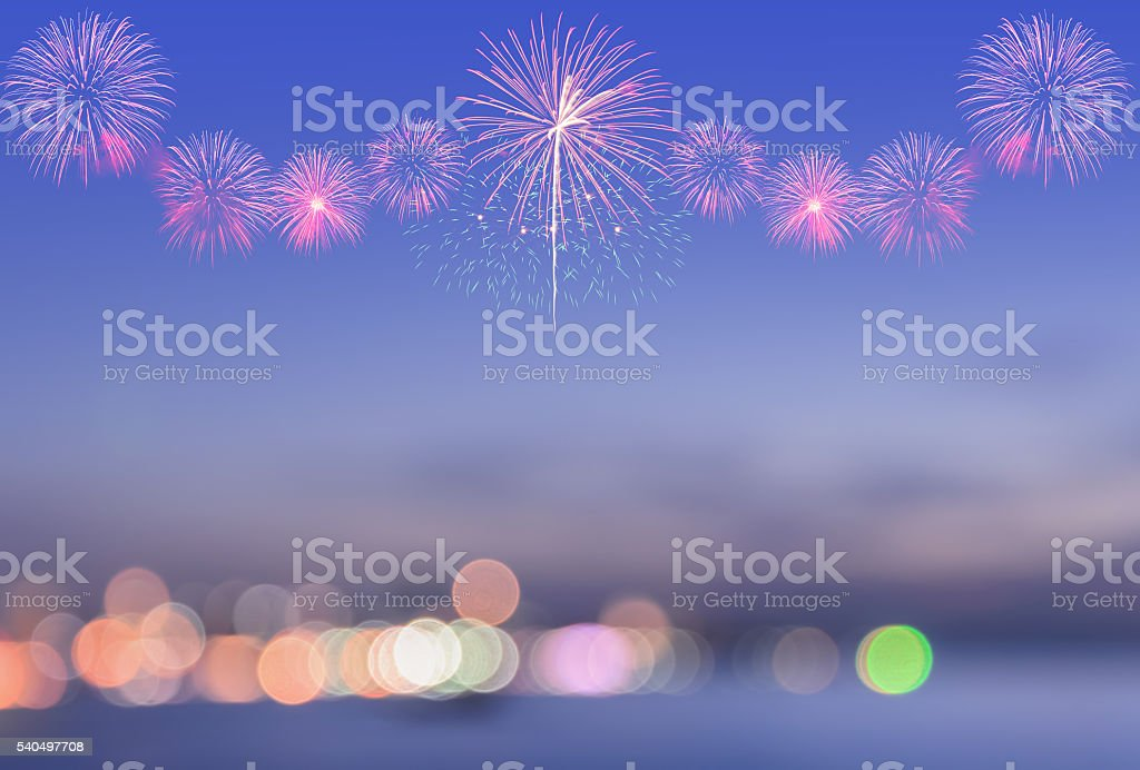 Blurred view of city bokeh with fireworks on sky stock photo