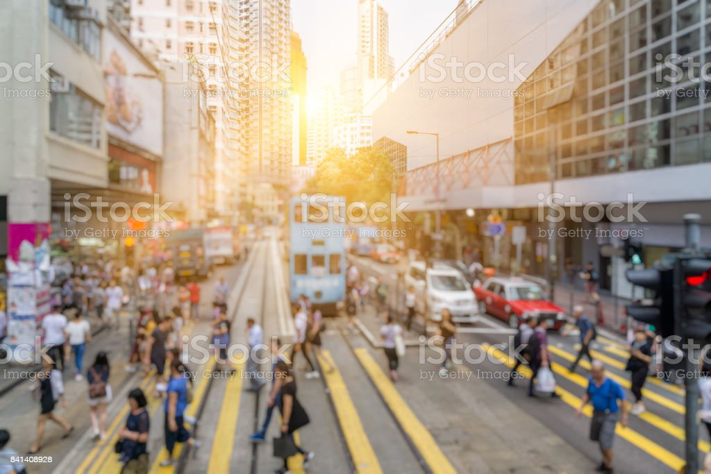 blurred view of pedestrians passing zebra crossing at Causeway Bay stock photo