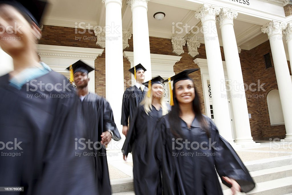 Blurred view of smiling young graduates stock photo