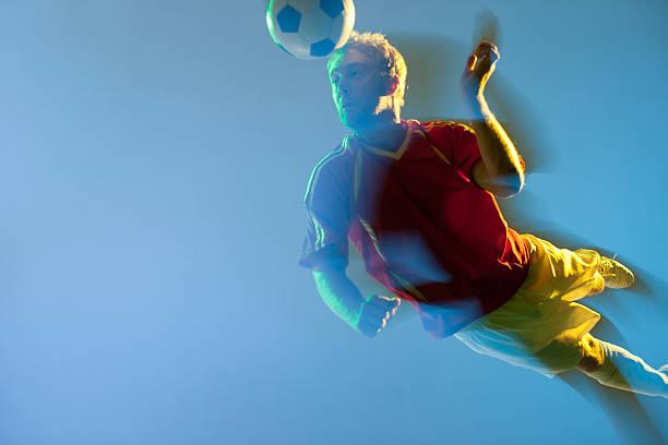 Blurred view of soccer player heading ball picture id168661505?b=1&k=6&m=168661505&s=612x612&w=0&h=ogtxvlfdwwzyfpt9umuftb3yv73ucgwqfejjfpn2niy=