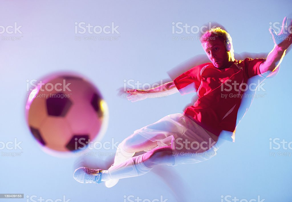 Blurred view of soccer player kicking ball royalty-free stock photo