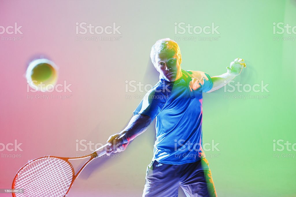 Blurred view of tennis player swinging stock photo