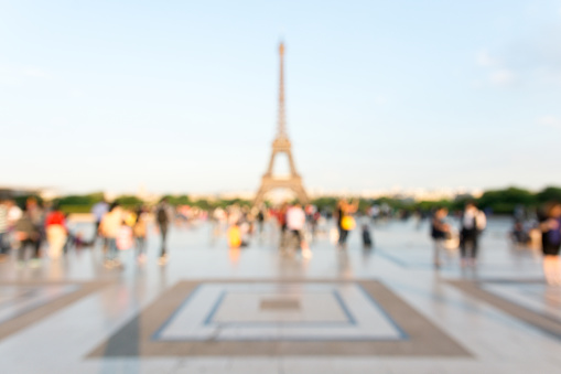 Blurred view of the Eiffel tower seen from the Trocadero esplanade