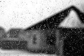 Blurred view through car window on winter season in black and white. Seasonal background texture for design.