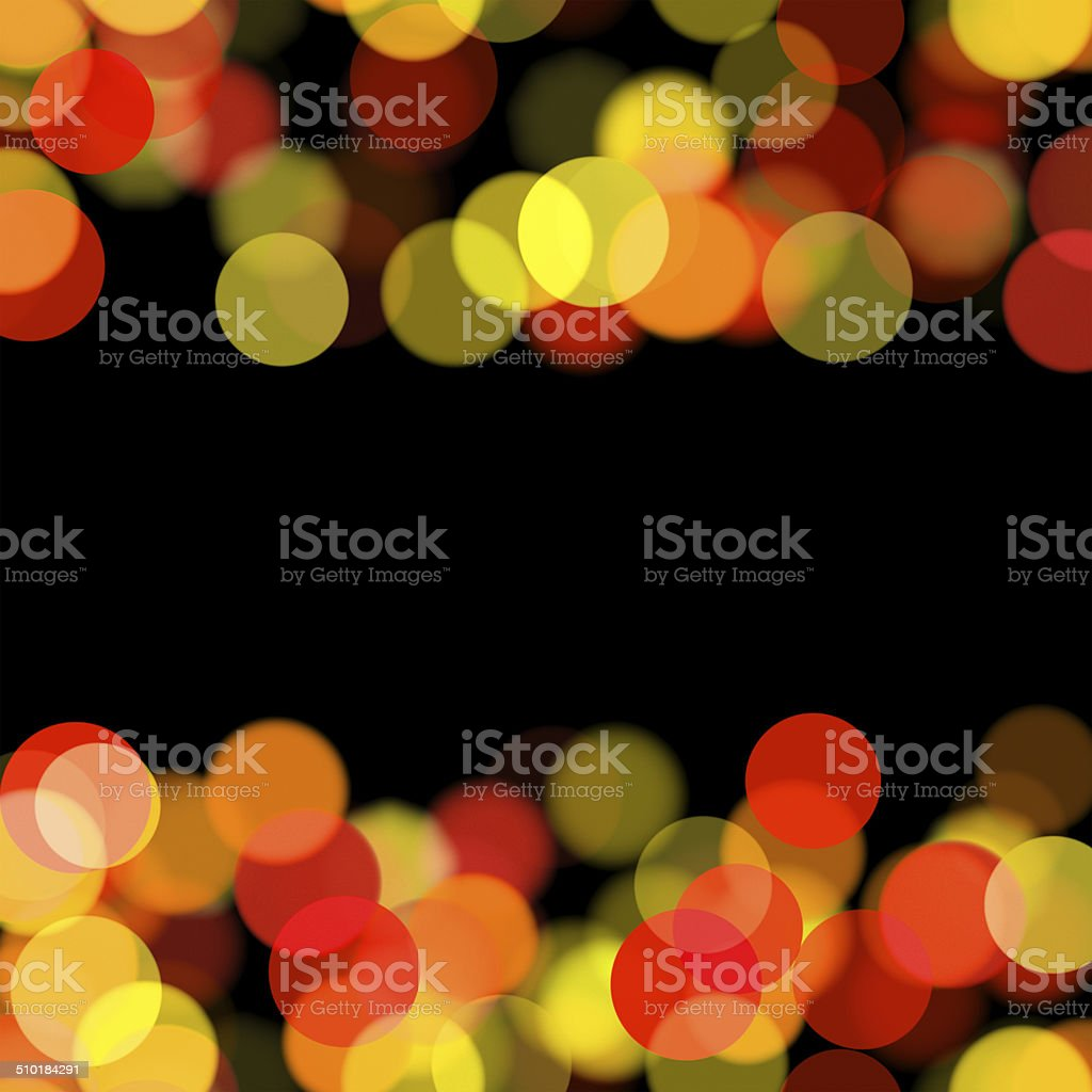 blurred warm tone dots on black background royalty-free stock photo