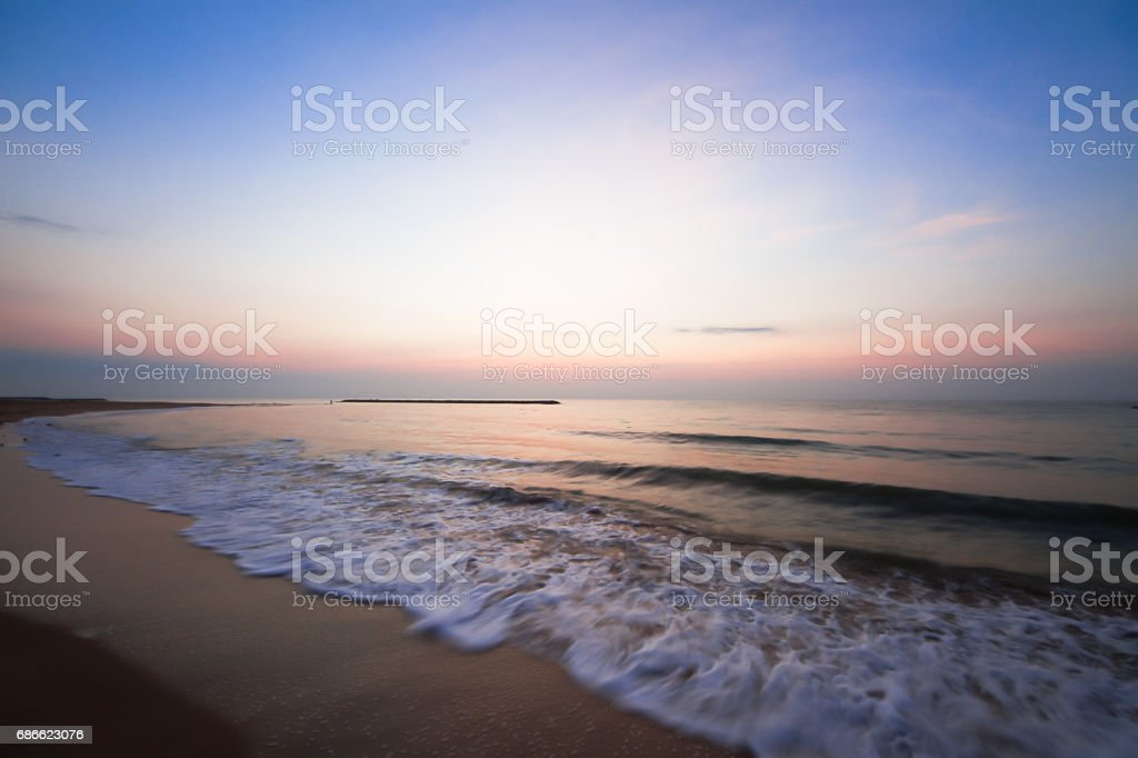 Blurred wave and beach during sunrise,Thailand royalty-free stock photo