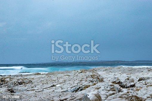 istock Blurred waves and sharp rocks in Mediterranean sea 942774358