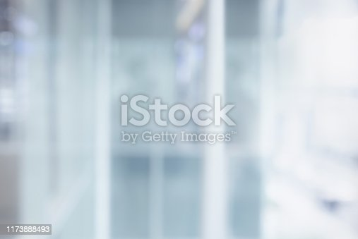 1019217082 istock photo Blurred white abstract glass wall from modern building 1173888493