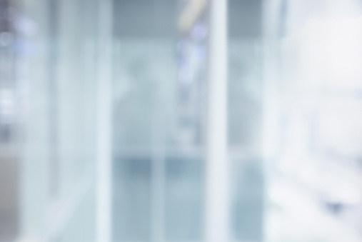664975574 istock photo Blurred white abstract glass wall from modern building 1173888493