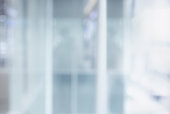 istock Blurred white abstract glass wall from modern building 1173888493