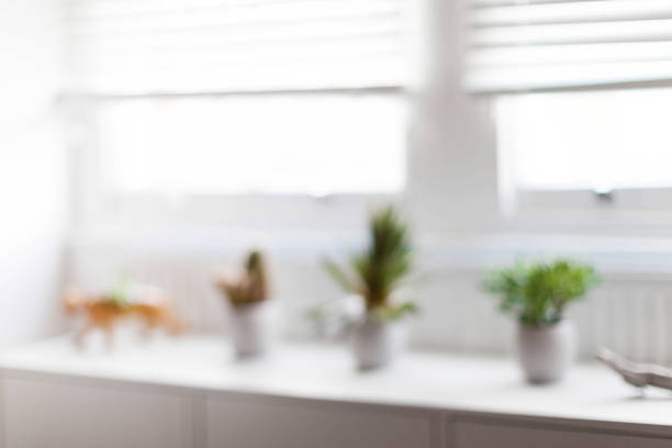 Blurred white living room with window stock photo
