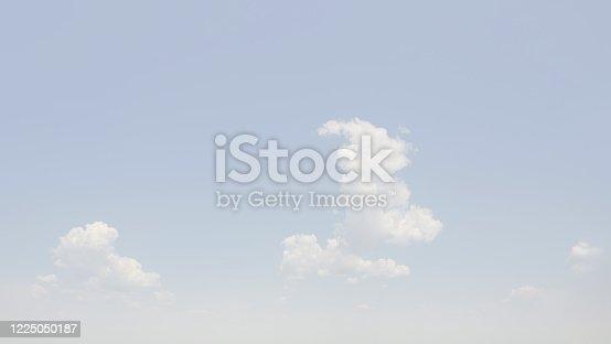 Blurred white soft background. Cumulus bizarre clouds in a haze. Backdrop for design