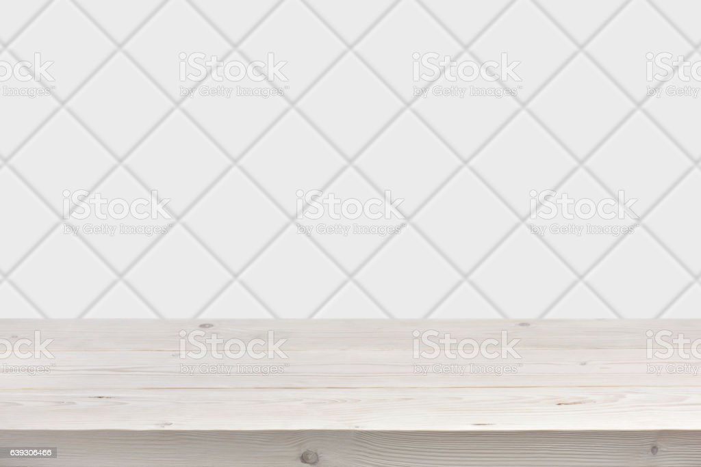 Blurred white tile wall background with wooden planks in front stock photo
