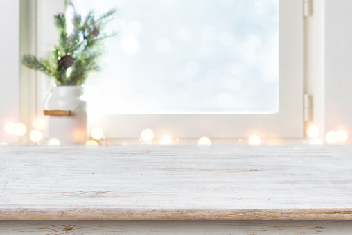 Blurred winter holiday background with vintage wooden table in front