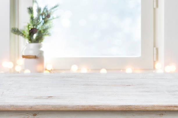Blurred winter holiday background with vintage wooden table in front stock photo