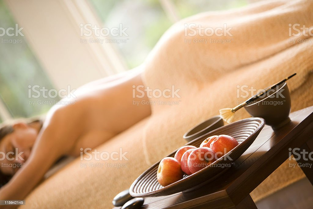 Blurred Woman on Massage Table in Spa stock photo