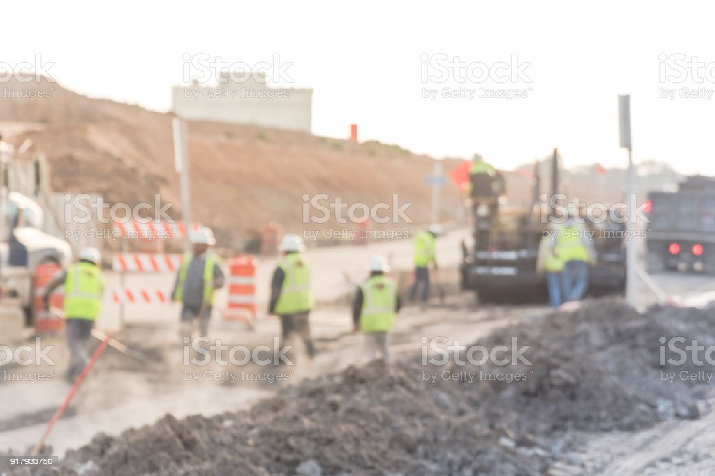 Blurred working yellow ride on roller asphalt compactor stock photo