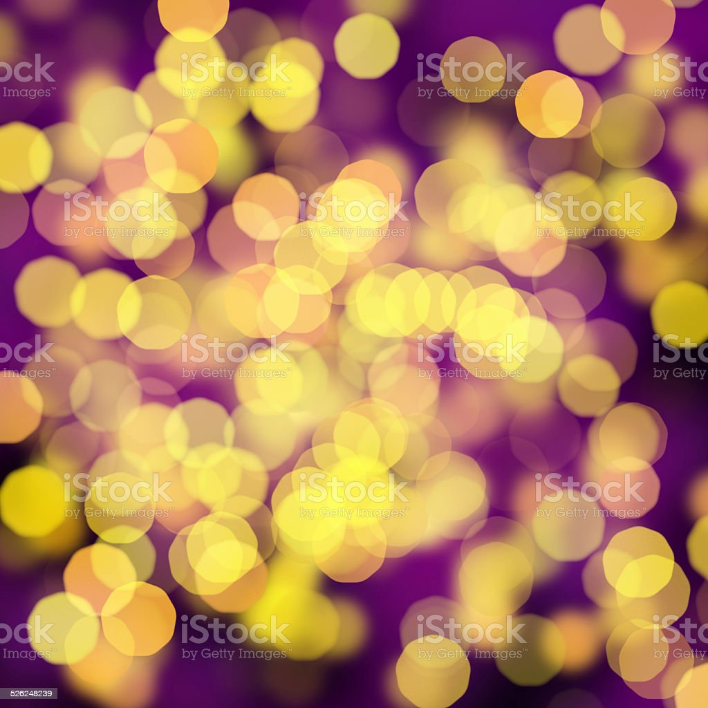 blurred yellow dots on purple background stock photo