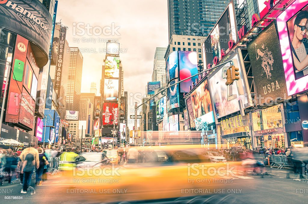 Blurred yellow taxi cab and rush hour in New York stock photo