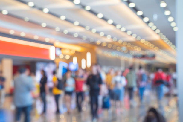 Blurred,defocused background of Crowd in trade event exhibition hall. Business trade show,shopping mall and marketing advertisement concept,MICE industry business concept Blurred,defocused background of Crowd in trade event exhibition hall. Business trade show,shopping mall and marketing advertisement concept,MICE industry business concept thailand mall stock pictures, royalty-free photos & images