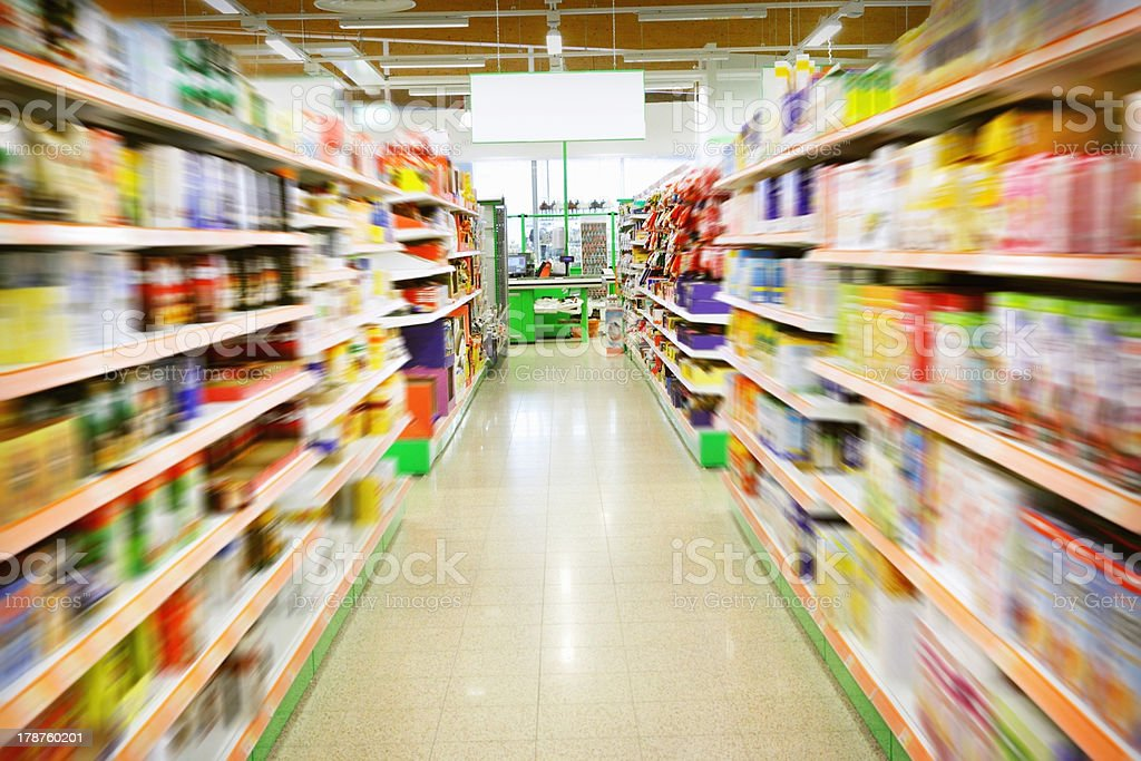 Blurred-motion view of supermarket aisle stock photo
