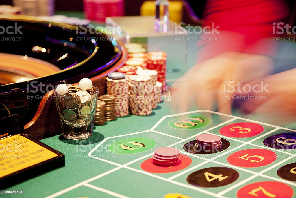 Blurried hands of a dealer at the roulette table royalty-free stock photo