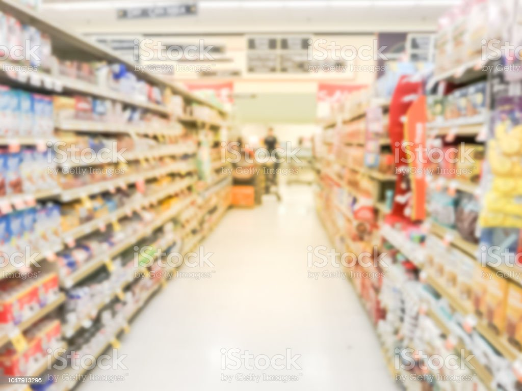 Blurry Background Customer Shopping For Baking Supplies At