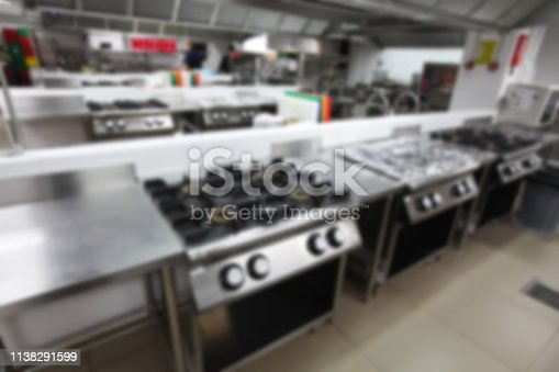 istock blurry background of kitchen with cooking equipment, Nobody inside. 1138291599