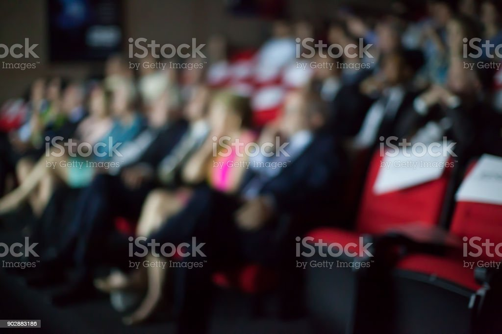 Blurry background of people watching movie in the movie theater. stock photo