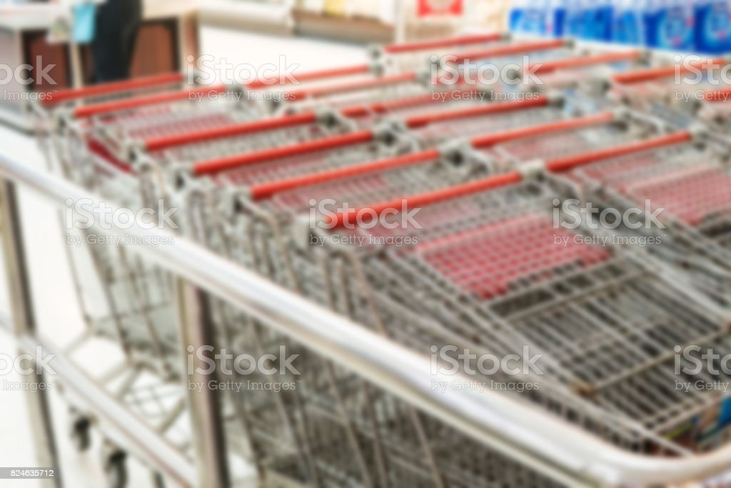 Blurry Background of shopping cart in supermarket. stock photo