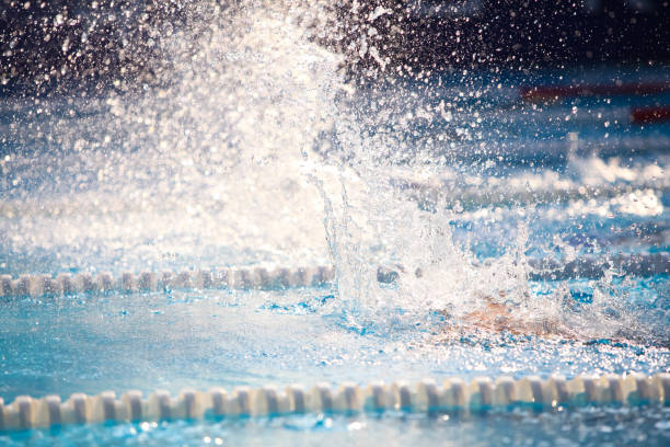 Blurry background of splash drop water on swimming race. Blurry background of splash drop water on swimming race. sopaatervinning stock pictures, royalty-free photos & images