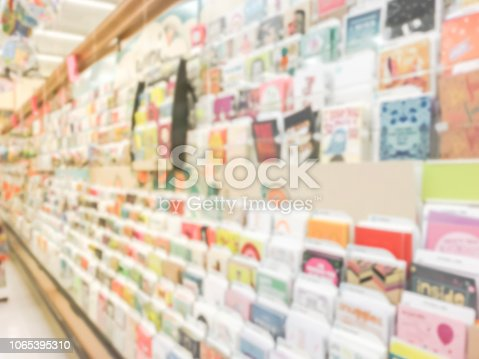 istock Blurry background variety of greeting cards on display at American supermarket 1065395310