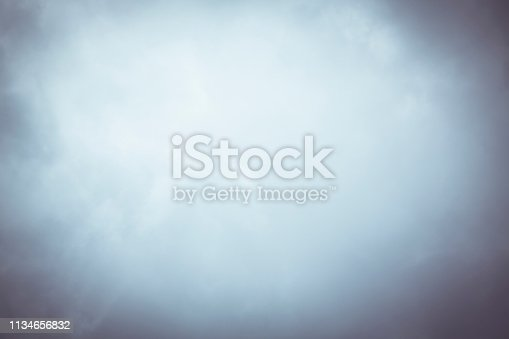 blurry cloudy sky with vignette for backgrounds