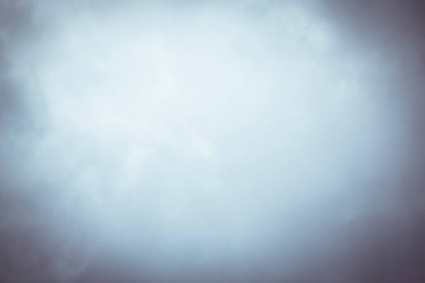 blurry cloudy sky with vignette for backgrounds stock photo
