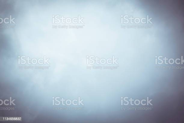 Photo of blurry cloudy sky with vignette for backgrounds