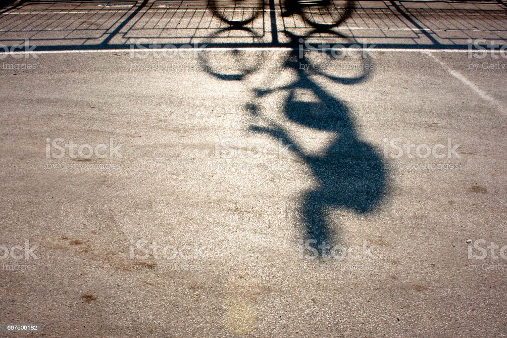 Blurry cyclist silhouette and shadow stock photo