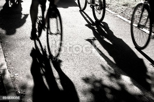 812812808 istock photo Blurry  cyclists silhouettes and shadows 694839056