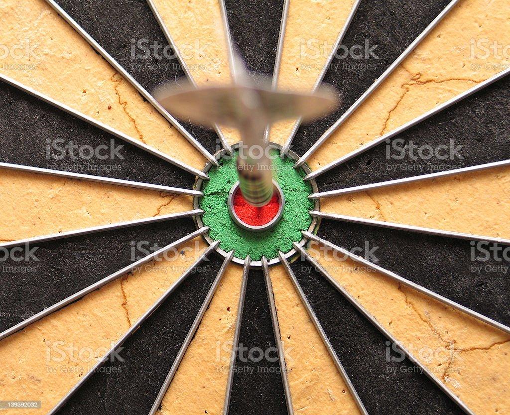 Blurry dart on clear bullseye dartboard royalty-free stock photo