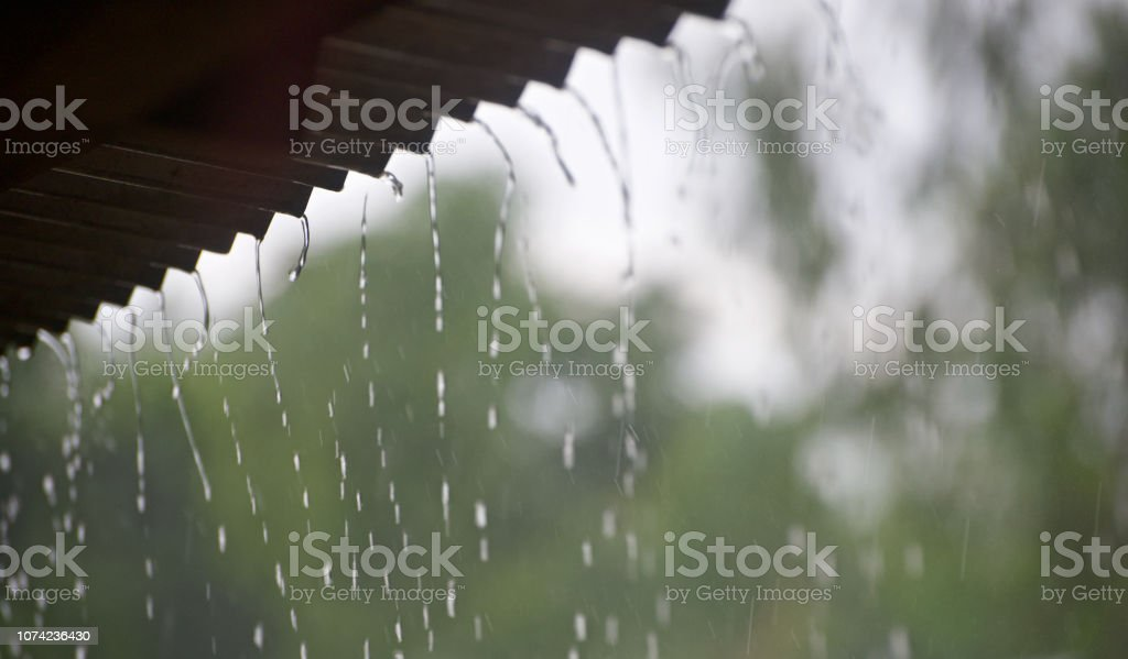 Blurry falling rain waters isolated unique photo stock photo