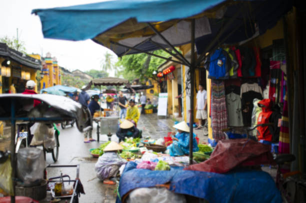 Blurry image of a colorful market on the streets of Hanoi in Vietnam. stock photo