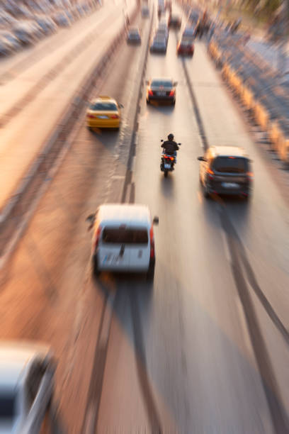 Blurry image of rush hour traffic on busy highway at sunset stock photo
