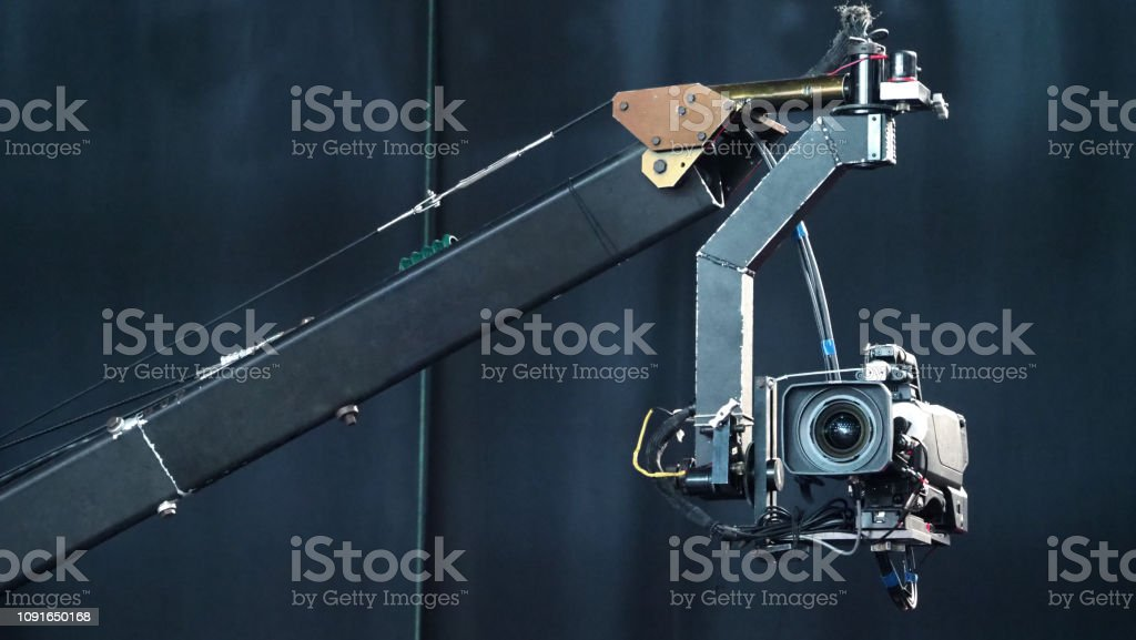 Blurry Images Of Broadcast Camera On The Crane Tripod For