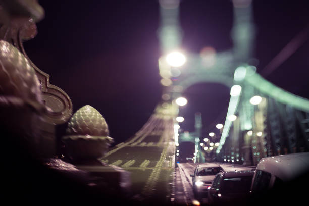 blurry Liberty bridge in Budapest at night stock photo