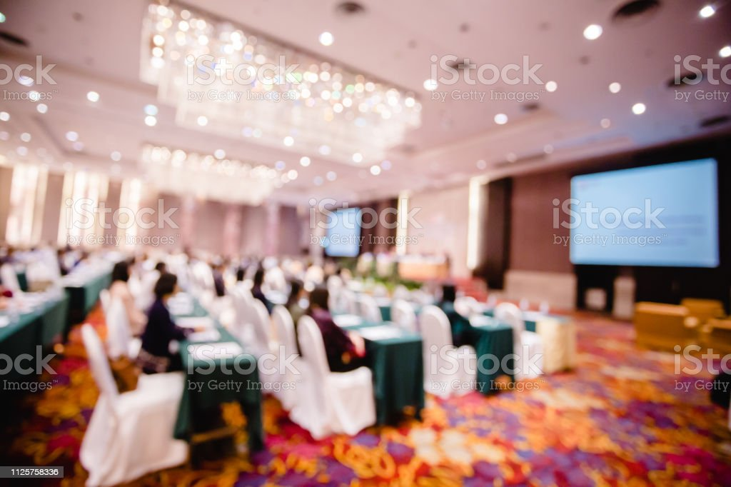 Blurry of auditorium and projector  for shareholders' meeting or seminar stock photo