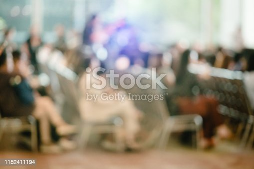 istock Blurry of auditorium for shareholders' meeting or seminar event 1152411194