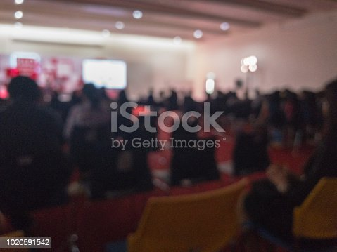 istock blurry of group of people in seminar room 1020591542