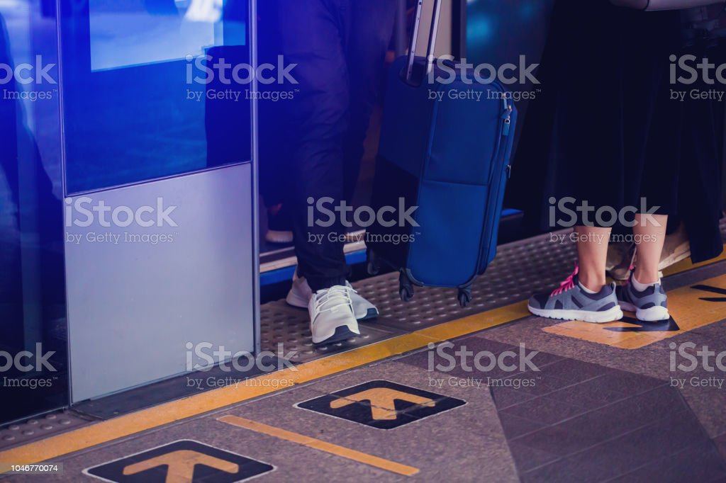 Blurry of people getting on and getting out electric sky train with automatic gateway stock photo