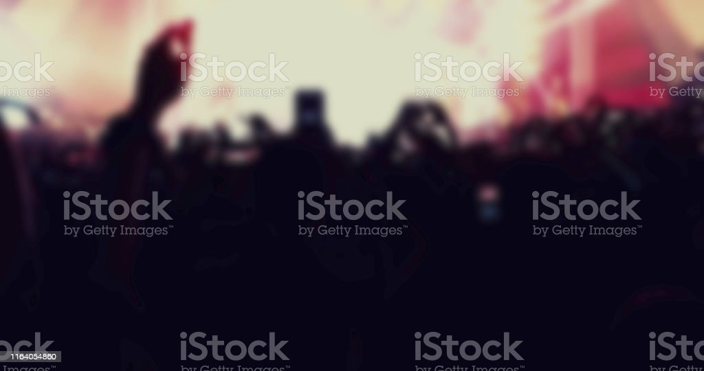 Blurry of silhouettes of concert crowd at Rear view of festival crowd...